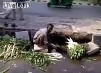 Man Washing Vegetables Using Sewerage Water In India